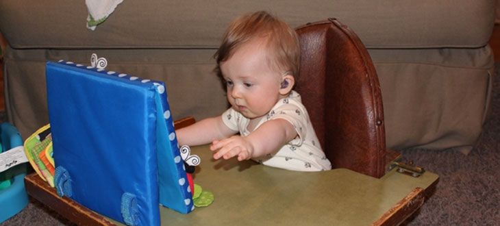 Frankie as a baby with his hearing aids.