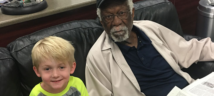 Frankie sits with Bill Russell at Starkey Hearing Technologies.