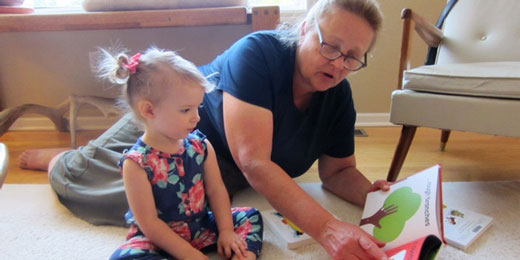 Jean, with her grandaughter here, enjoys how her hearing aids help her granddaughter's laughter again.